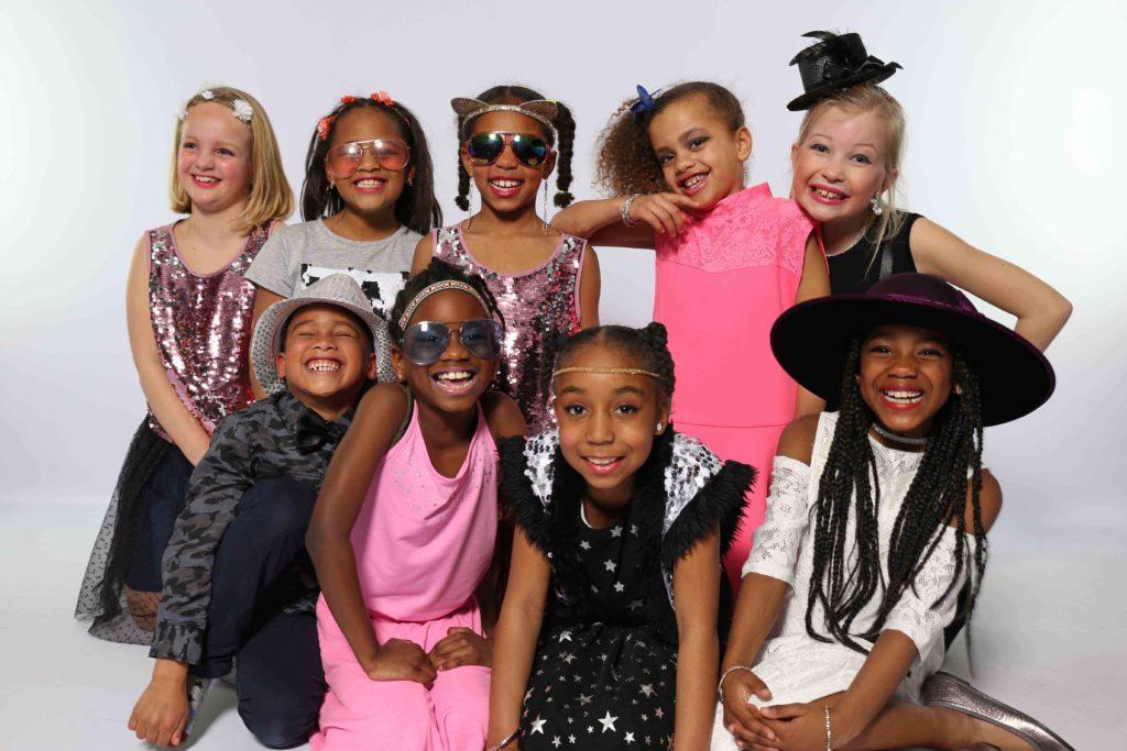 Er tip top uitzien en een groepsfoto. Een droom voor elk meisje.