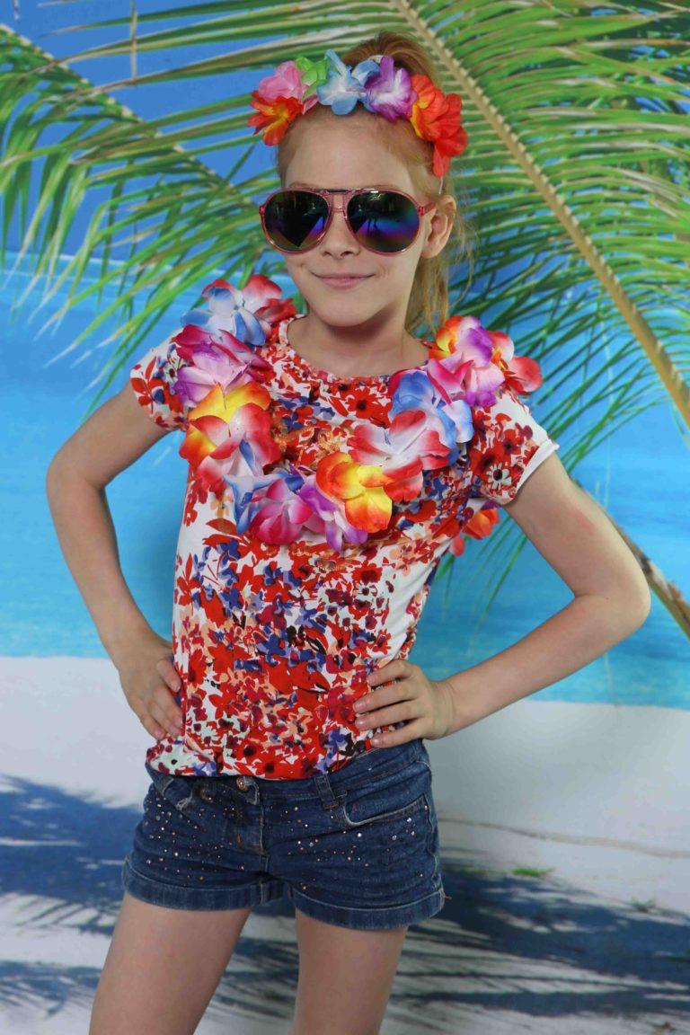 Kinderfeestje met Ibiza fotoshoot in Almere, verjaardagsfeestje en als model op strandzand met tropisch decor.
